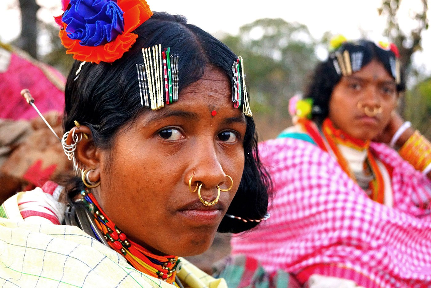 Closeup of an adivasi woman with her traditional jewellery
