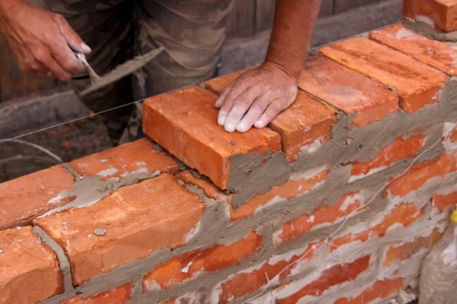 Leadership Building Laying Bricks