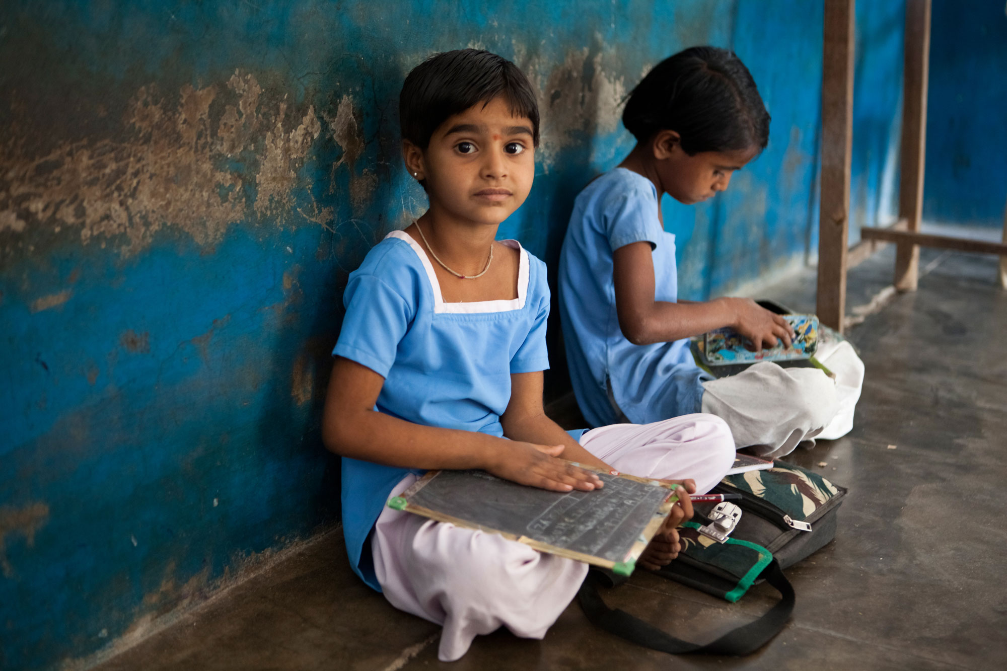 Two young government girls studying