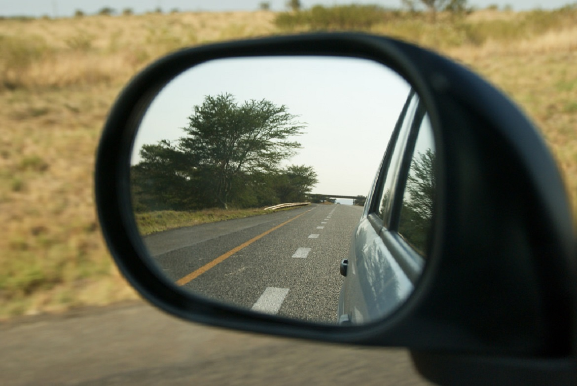 the road in a rearview mirror
