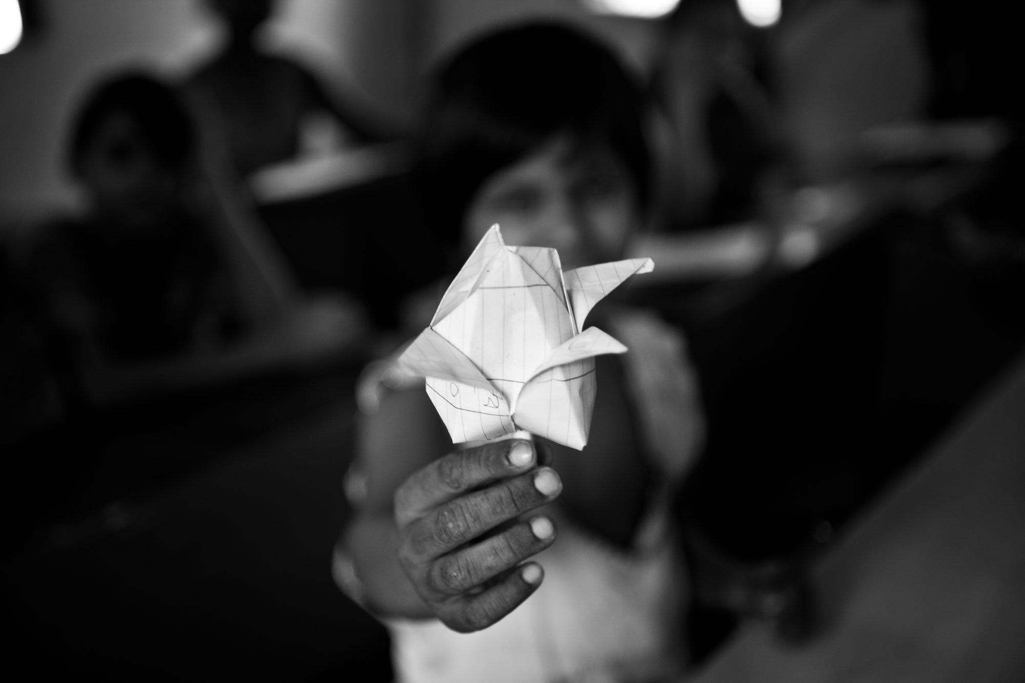 A child offering a paper flower_human trafficking_uma sanjog