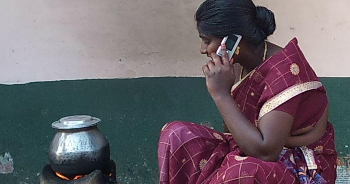 Village woman talking on the phone