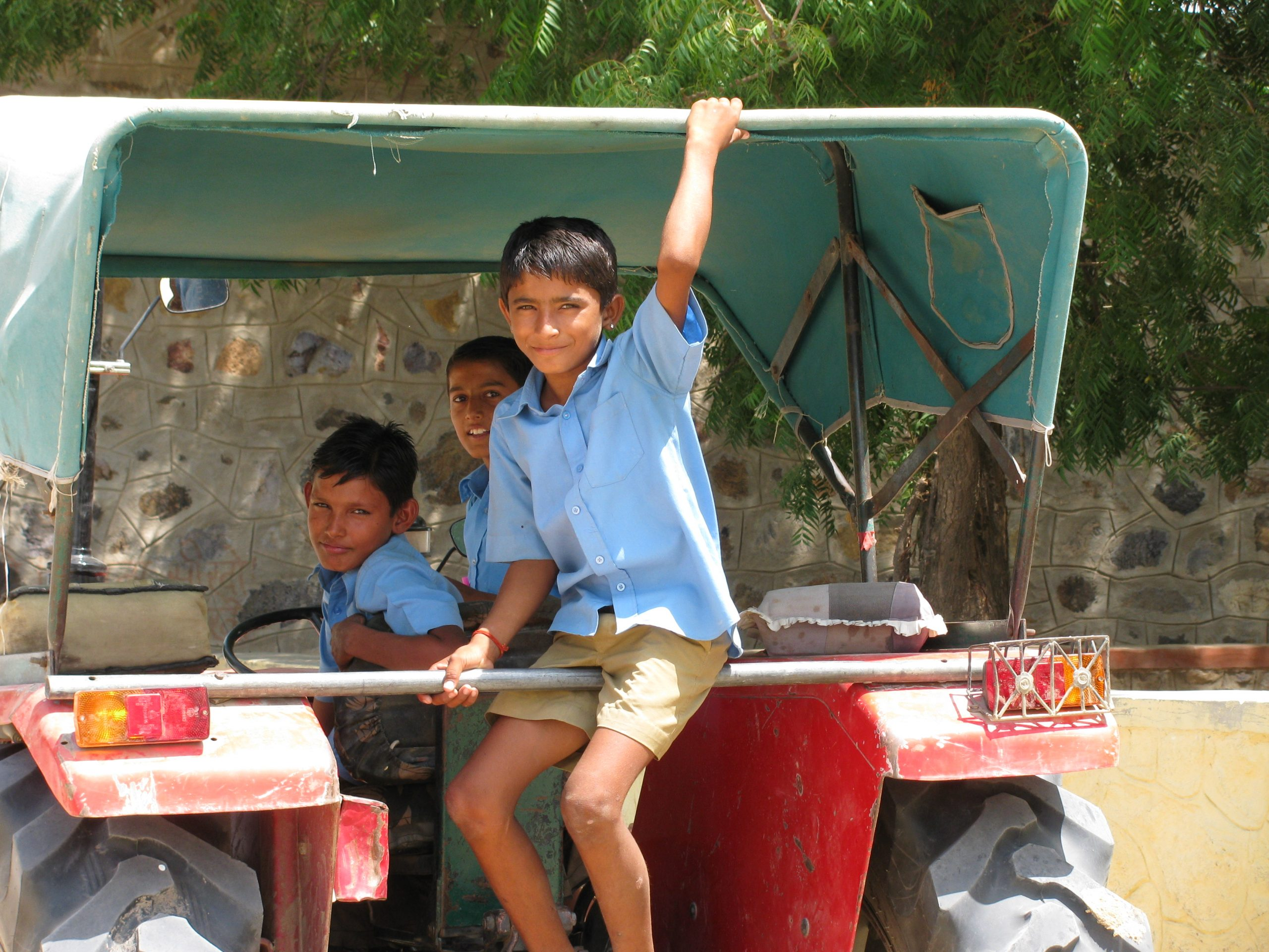 Social sector fellowships boys sitting on the back of a truck in rajasthan