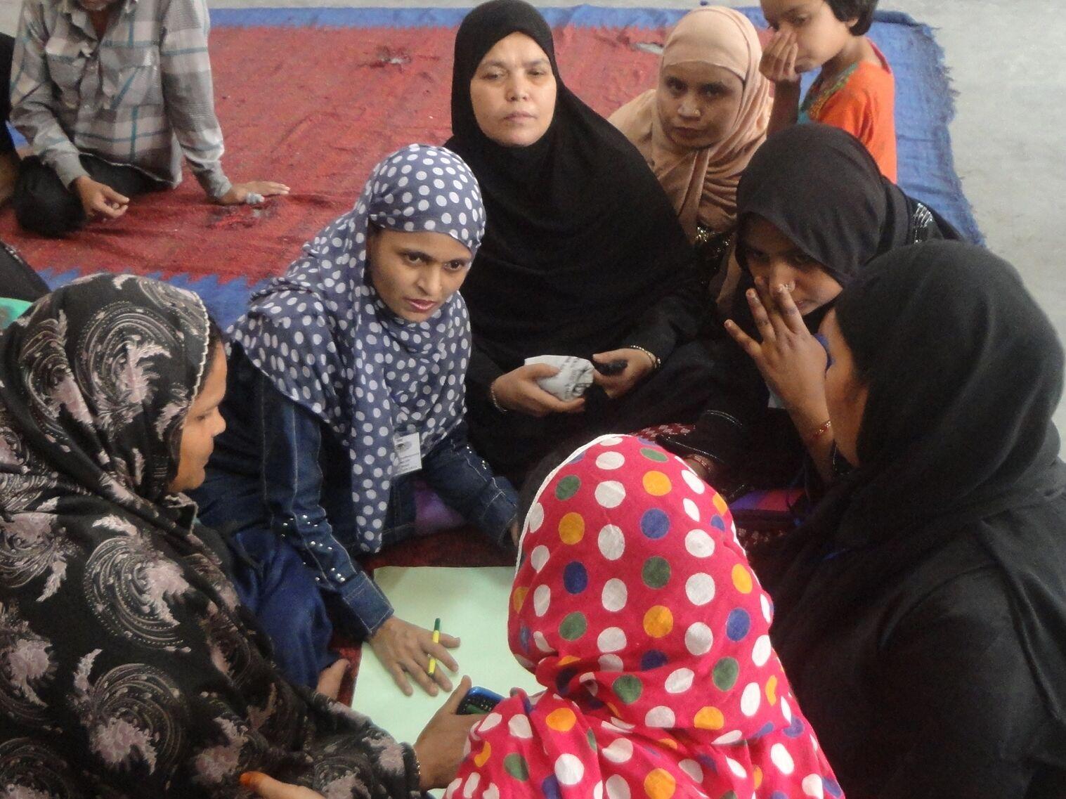 Burkha clad women discussing amongst themselves