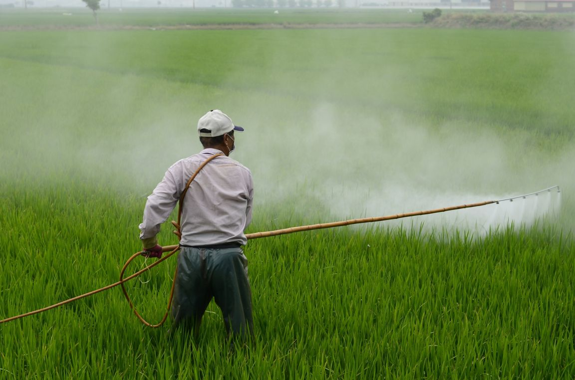 farmer spraying pesticide-health