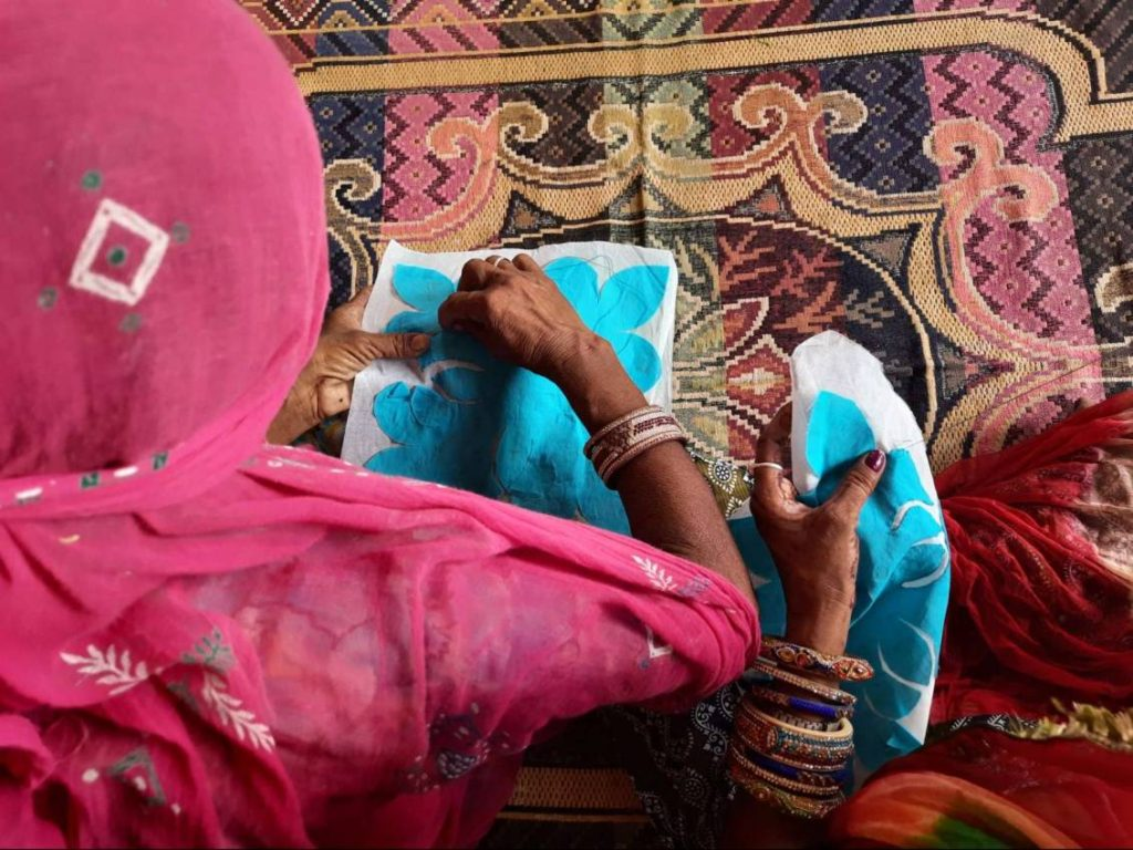 top view of two women artisans doing embroidery