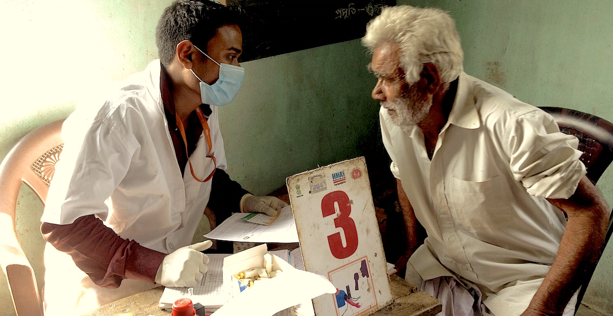 India's public health system doctor checking a patient