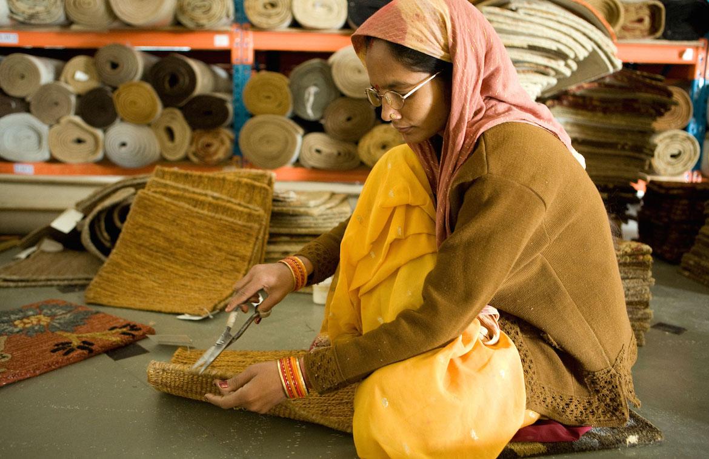 woman weaving mats financial inclusion