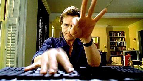 Jim Carrey typing on laptop in Bruce Almighty