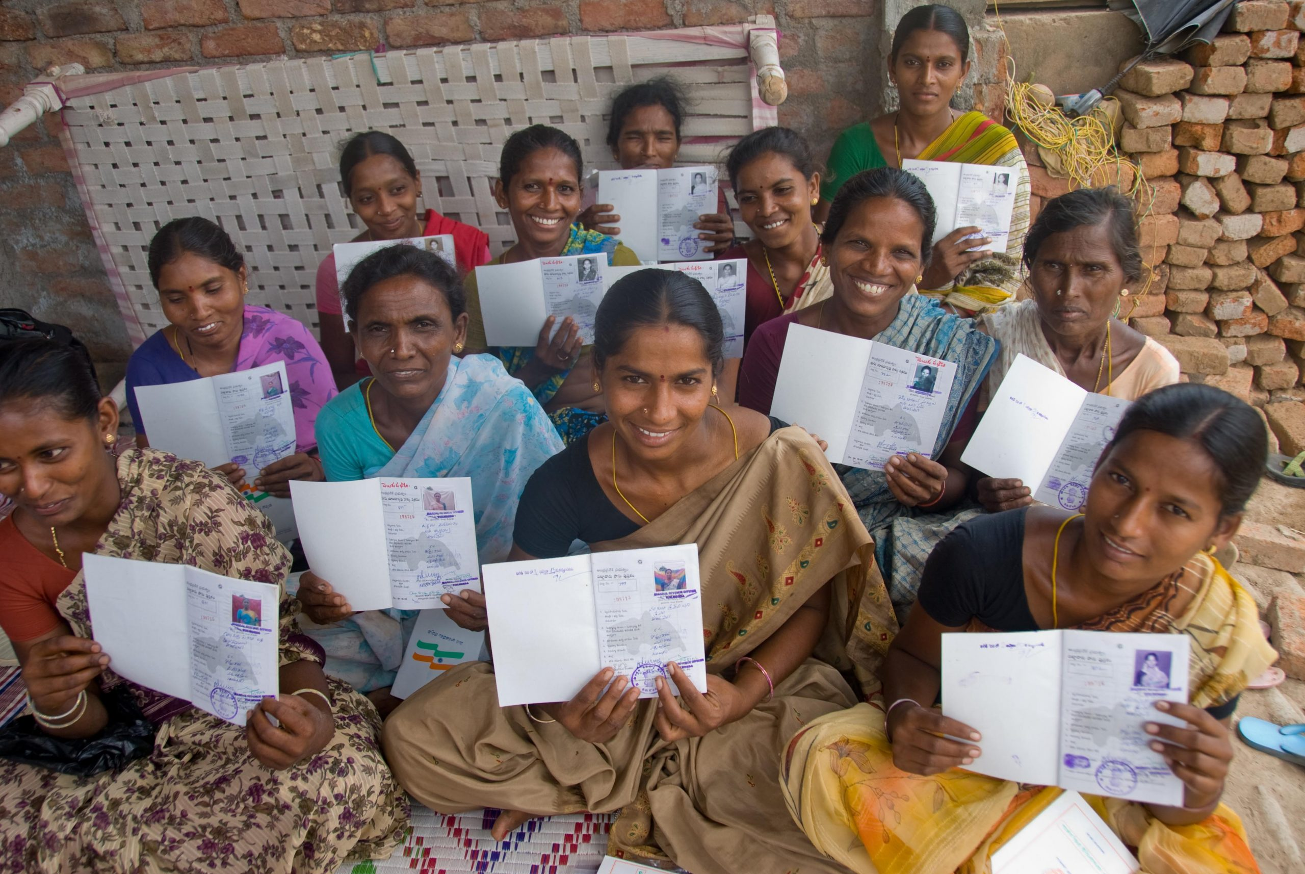 a group of women holding some kind of a personal document