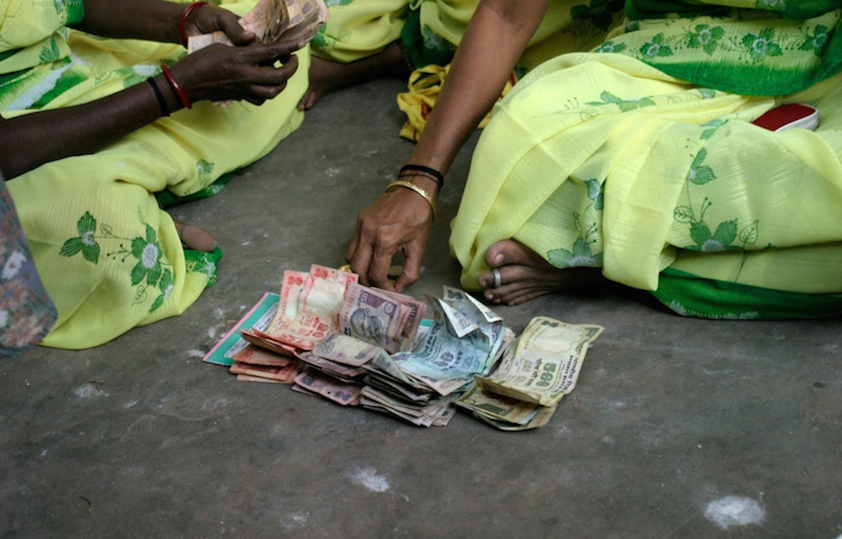 Microfinance women counting money