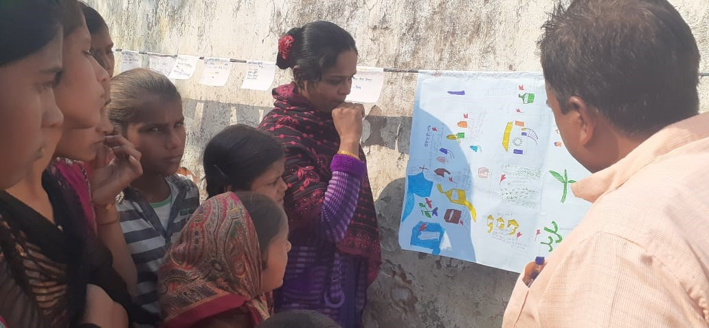Munni Devi showing unsafe locations in the community-child protection