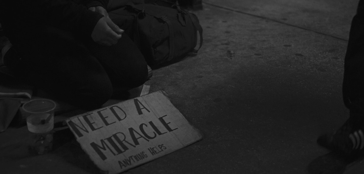 Indian Homeless person with sign
