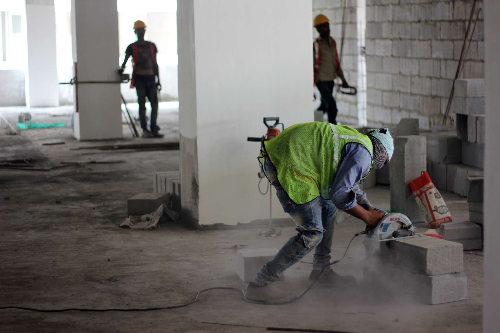 a construction worker working on an indoor worksite-construction workers welfare