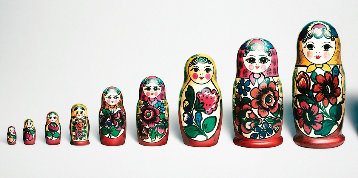 paperweights with designs of dolls on them placed in ascending order of height