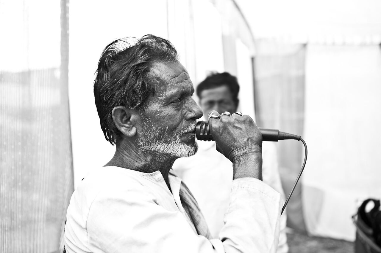 An old man speaking on the mic