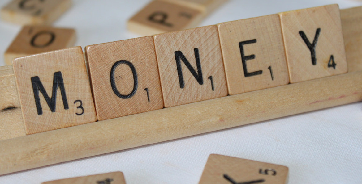 Scrabble letters spelling out the word money
