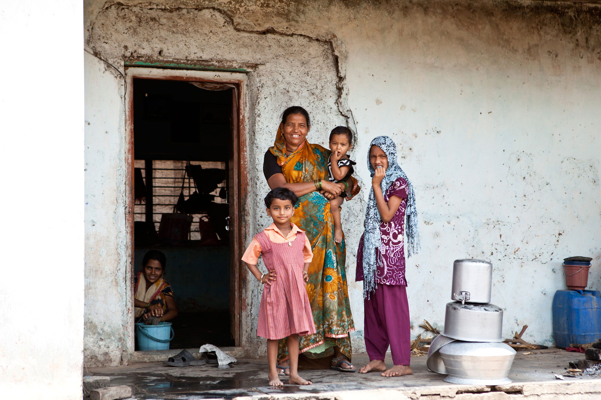 Mother and children standing outside a toilet on World Toilet Day