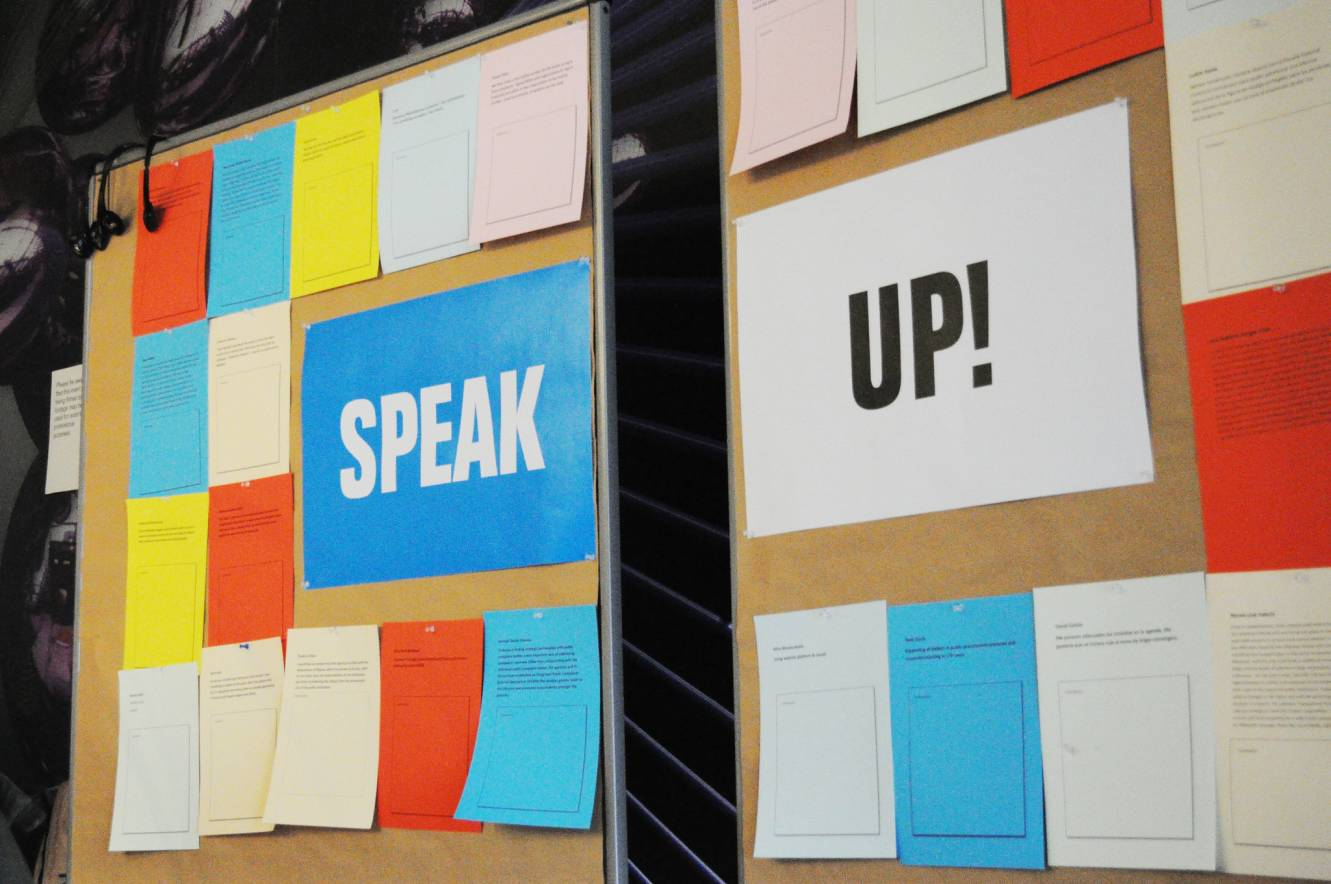 a board with speak up written on it-speak up