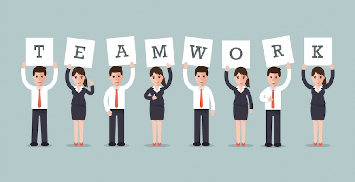 Business people holding up teamwork sign