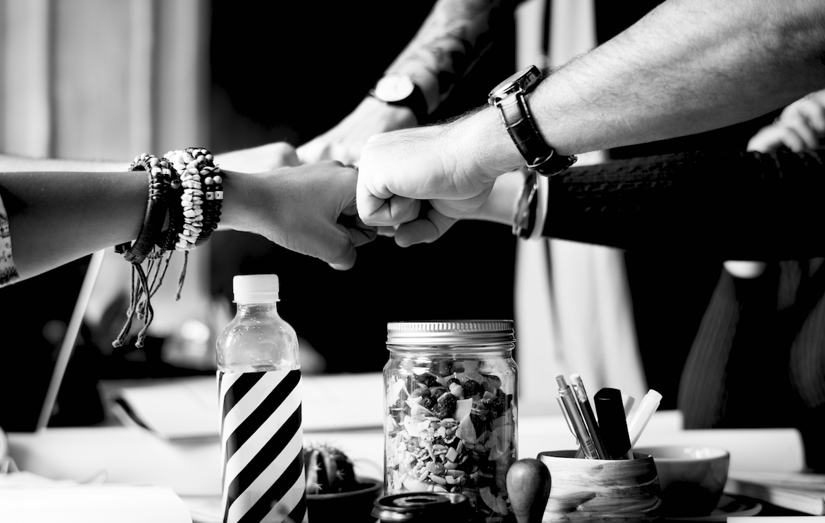 Business Colleagues Together Teamwork Working Office fist bumping