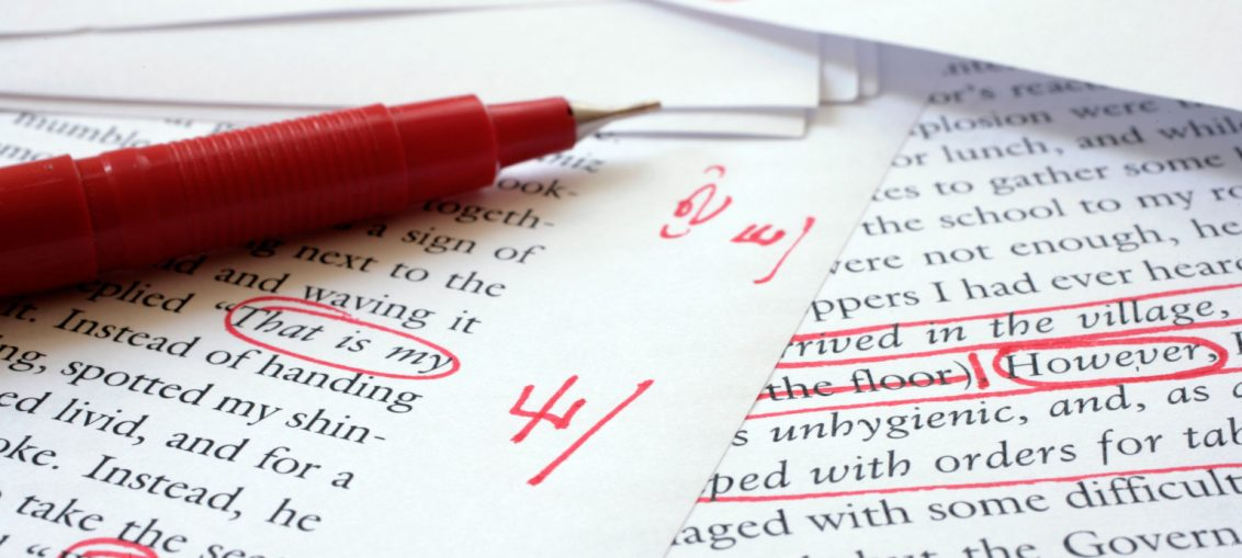Text being edited with a red pen_Wikimedia Commons