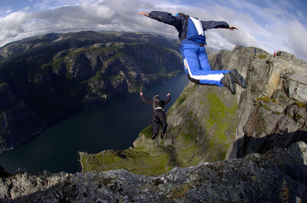 two skydivers jumping off a cliff-risk management_Wikimedia commons_philanthropy