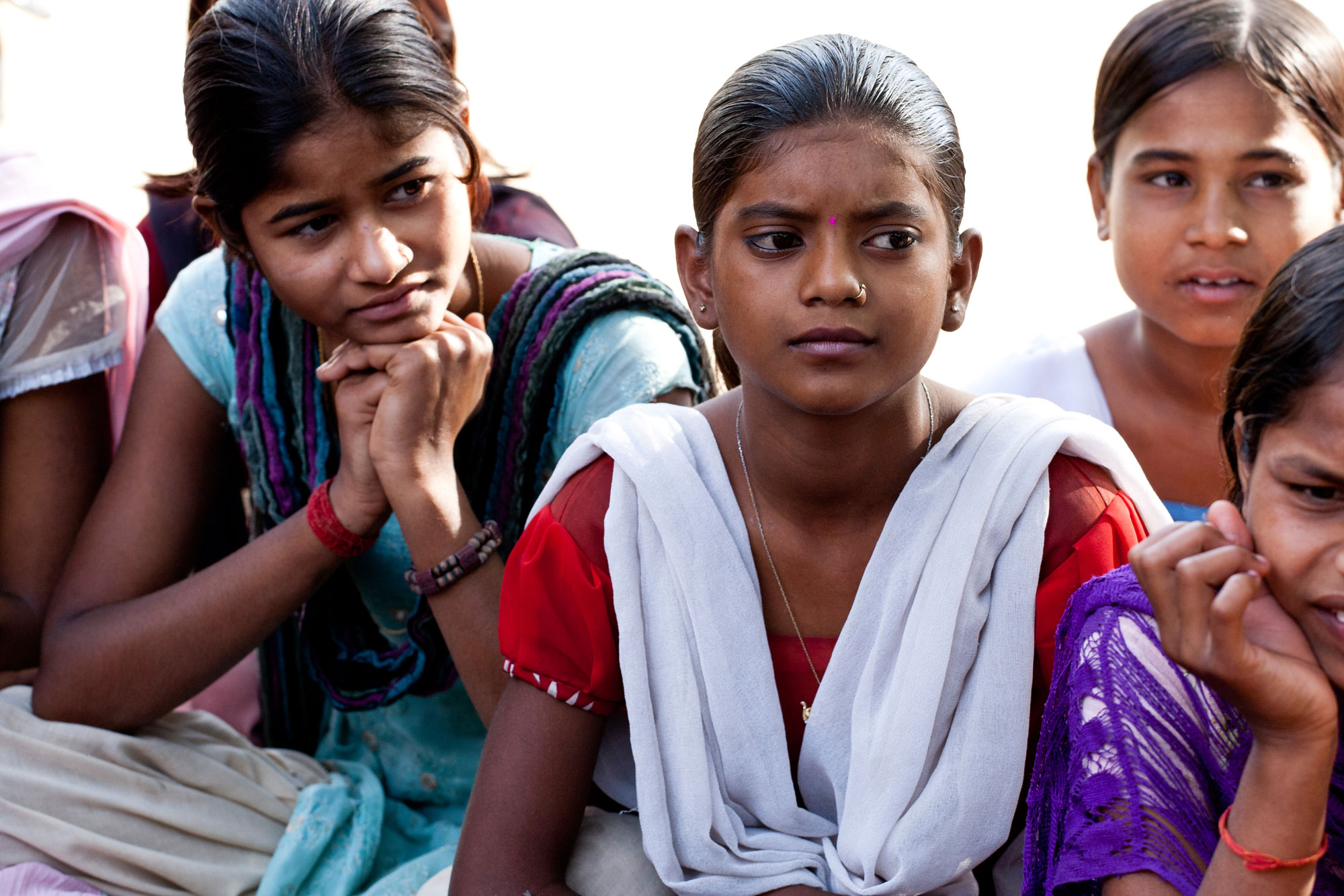 Young Indian girls sitting together