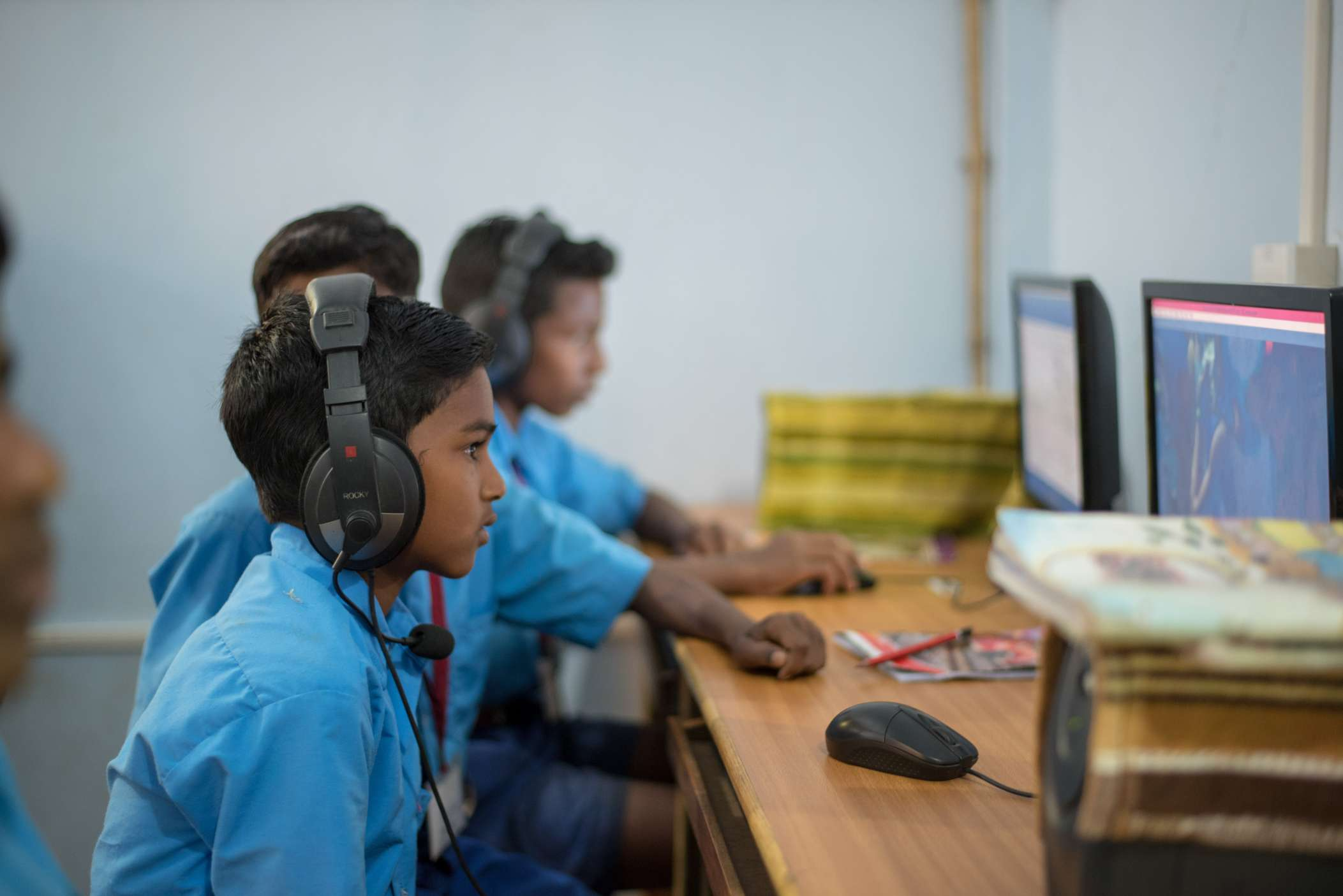 a student with headphones_edtech_ajaya