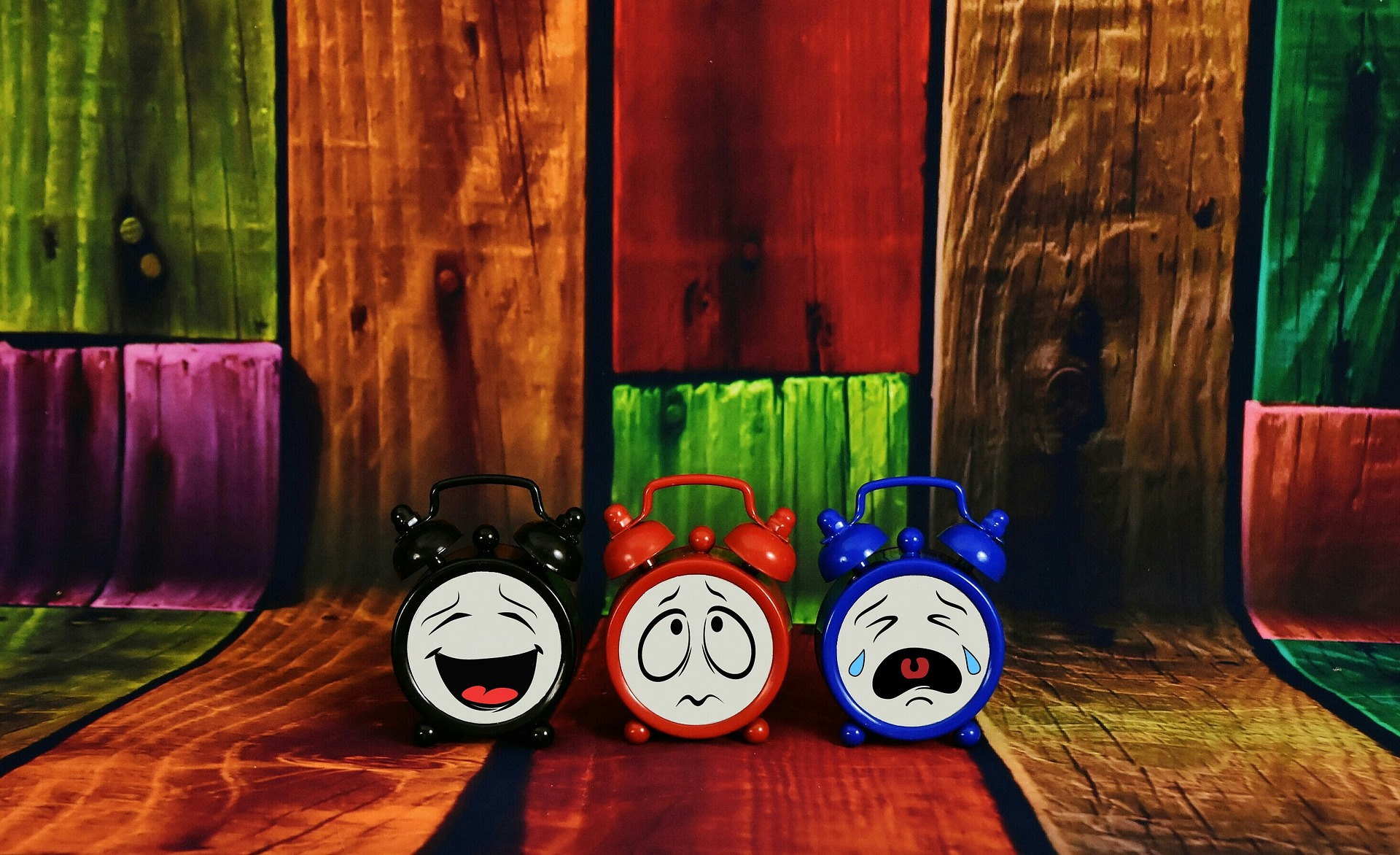 3 alarm clocks, each having different expressions