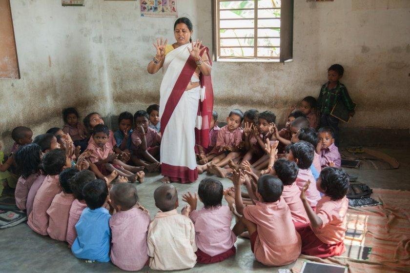 anganwadi worker teaching children - primary education