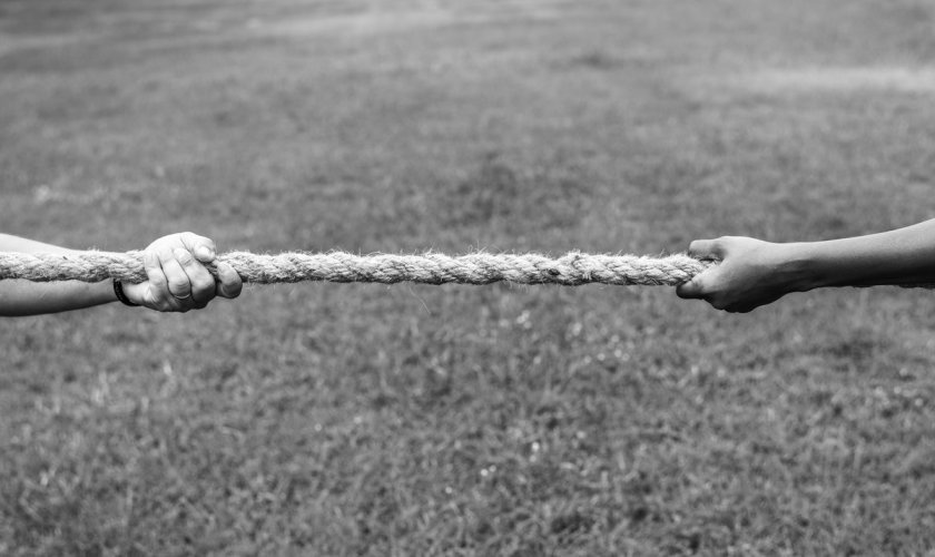 black and white picture of people in a tug of war_rawpixel