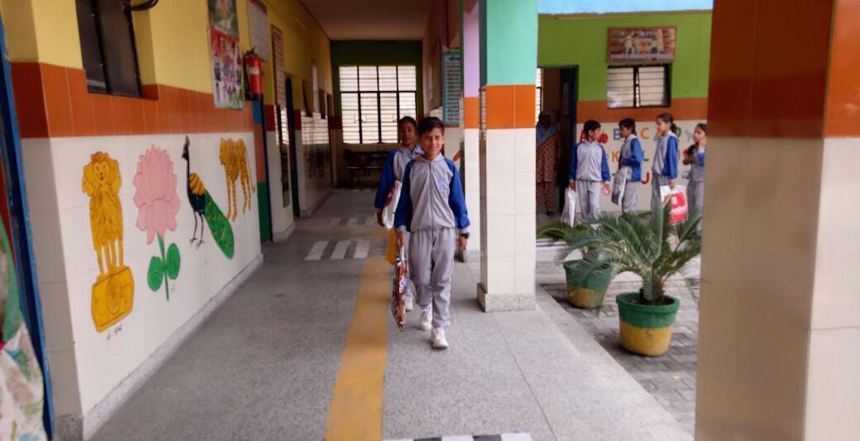 Boy walking in school