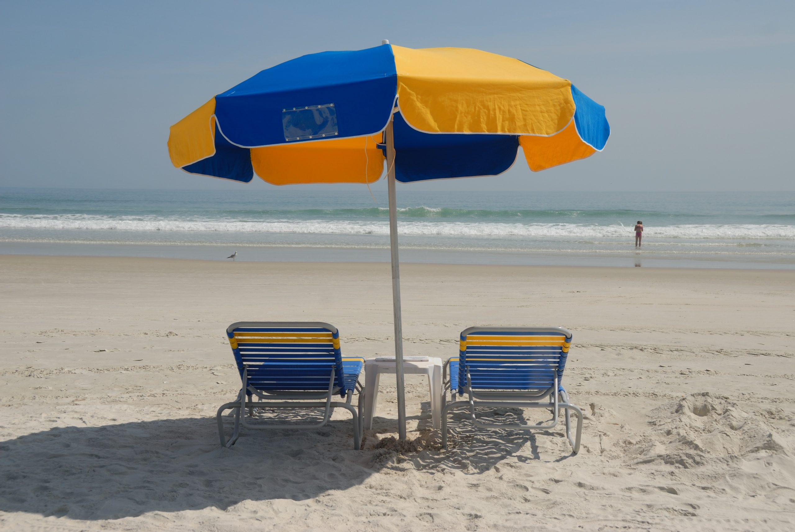 chairs and umbrella on beach_pxhere_nonprofit humour