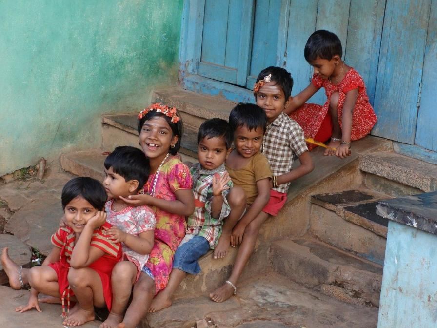 children sitting in a line on steps-children