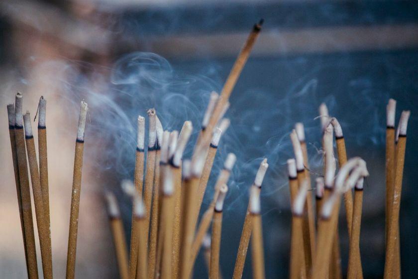 Close up of burning incense sticks