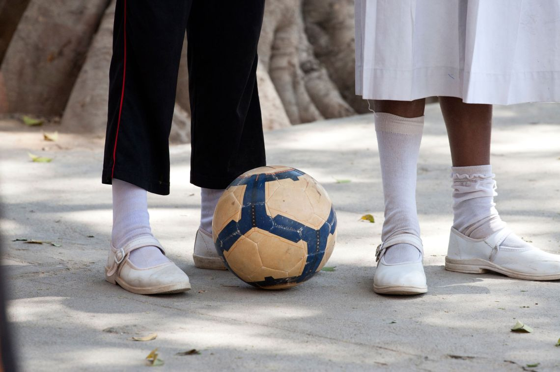 close up of football with the feet of school children_Charlotte Anderson
