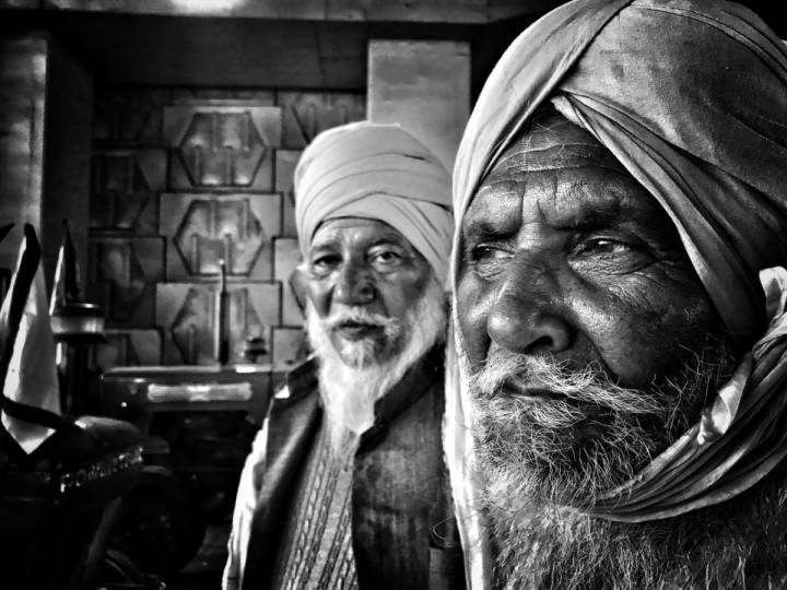 Close up of two bearded men wearing turbans- farmers protest