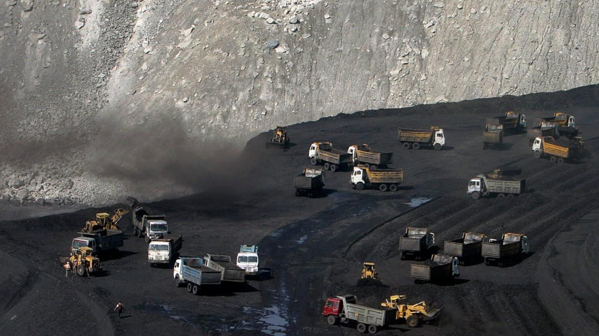Trucks on a coal reserve in India-Adivasi-Reuters