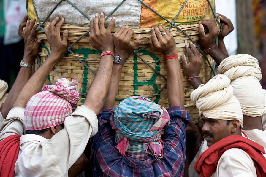 coolies pushing a heavy load in kolkata-informal workers