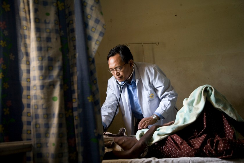 doctor attending to a patient-universal healthcare