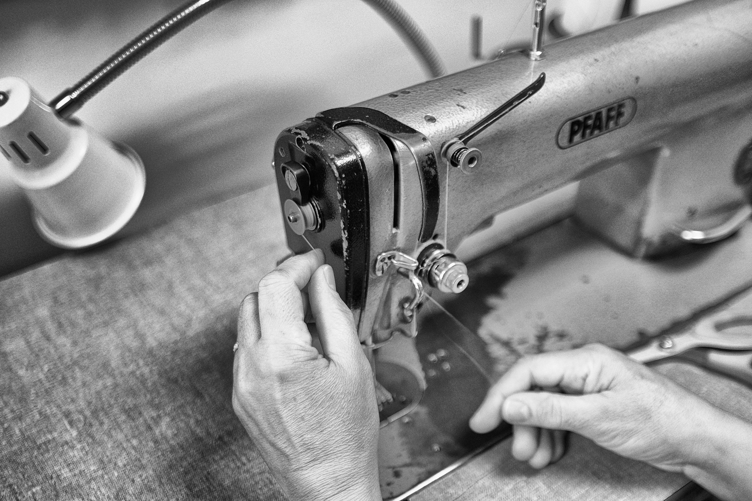 hands working on a tailoring machine-skilling