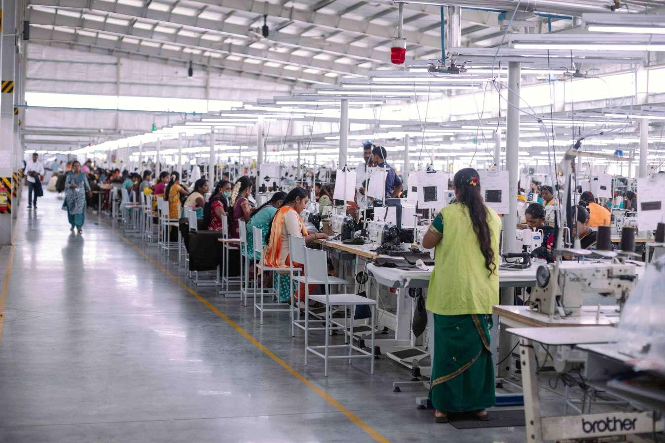 line of women workers in garment factory_PC Nayantara Parikh