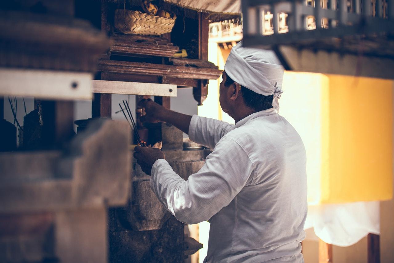 A man holding an agarbatti