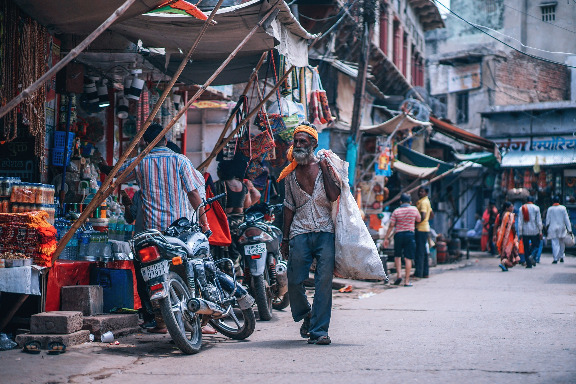 A poor man walking in the market place