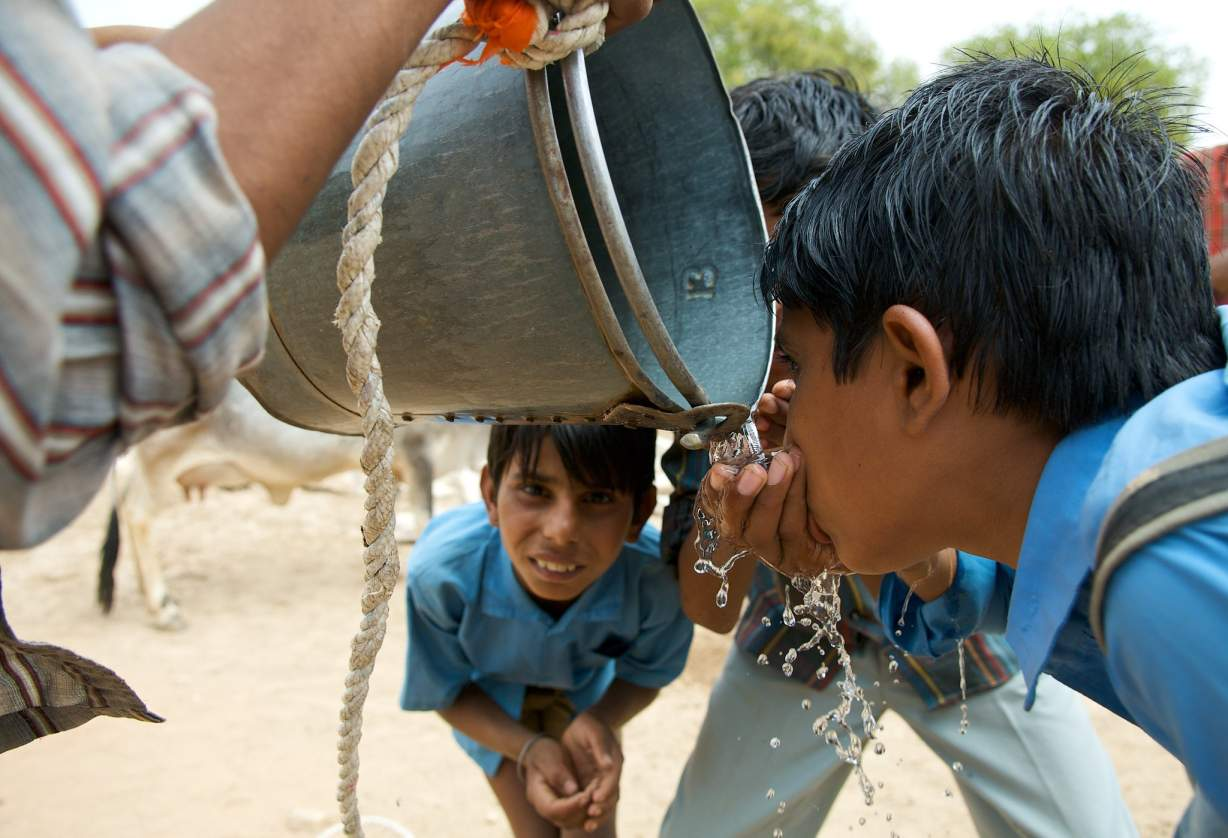 school boys drinking water-water