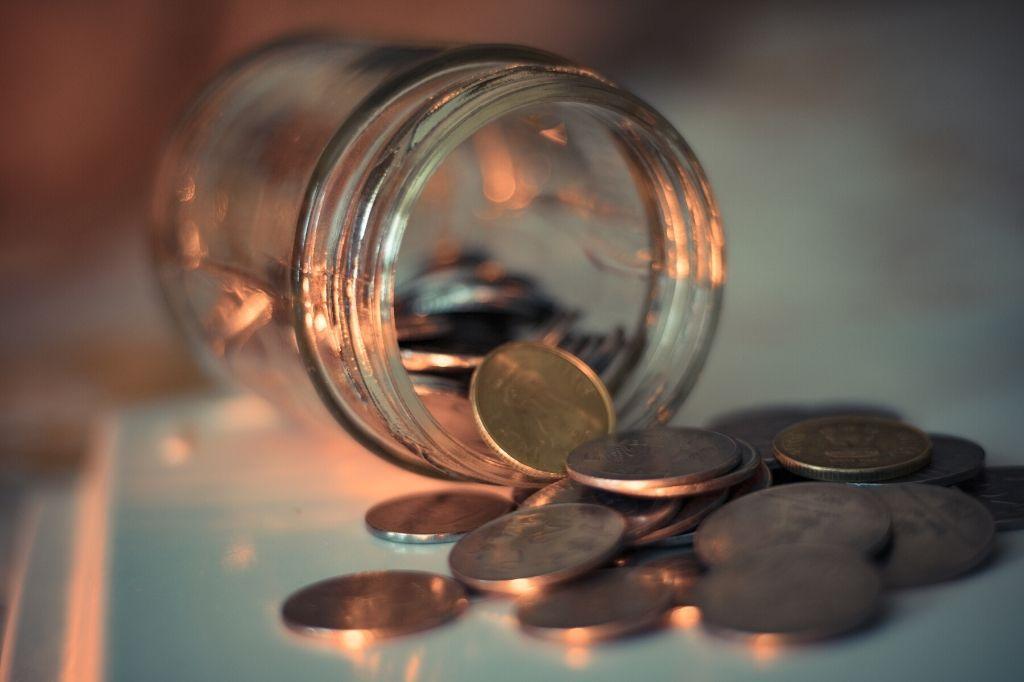 spilled indian coins_social stock exchange_unsplash