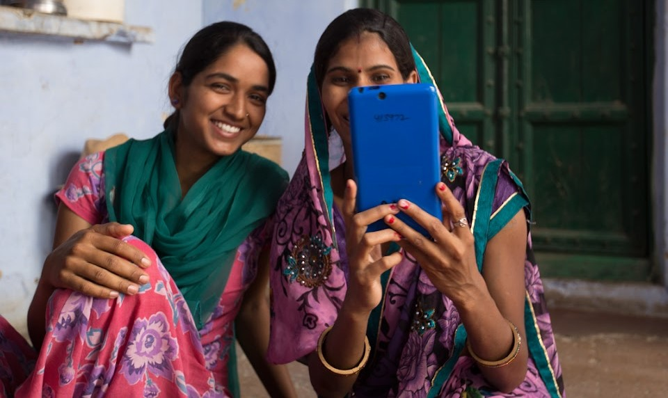 2 village women taking a selfie