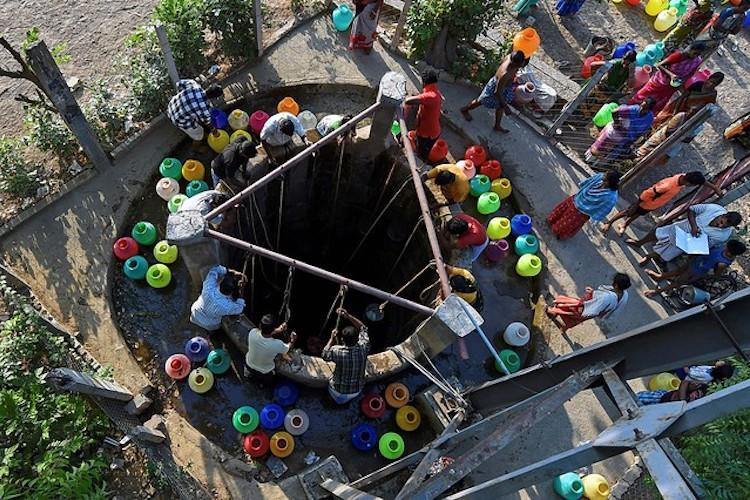 People taking water from well_PTI