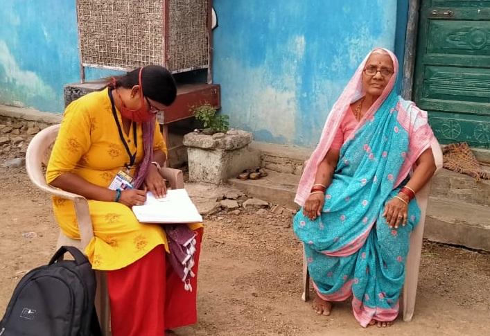 woman conducting a survey with an elderly woman_Piyush Khanorkar